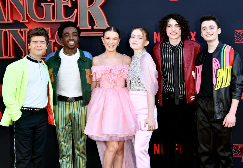 "SANTA MONICA, CALIFORNIA - JUNE 28: (L-R) Gaten Matarazzo, Caleb McLaughlin, Millie Bobby Brown, Sadie Sink, Finn Wolfhard, and Noah Schnapp attend the premiere of Netflix's ""Stranger Things"" Season 3 on June 28, 2019 in Santa Monica, California. (Photo by Amy Sussman/Getty Images)"