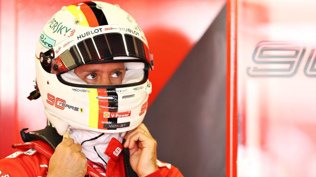 NORTHAMPTON, ENGLAND - JULY 12: Sebastian Vettel of Germany and Ferrari prepares to drive in the garage during practice for the F1 Grand Prix of Great Britain at Silverstone on July 12, 2019 in Northampton, England. (Photo by Mark Thompson/Getty Images)