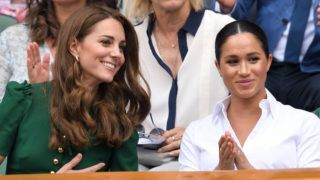 LONDON, ENGLAND - JULY 13: Catherine, Duchess of Cambridge and Meghan, Duchess of Sussex in the Royal Box on Centre Court during day twelve of the Wimbledon Tennis Championships at All England Lawn Tennis and Croquet Club on July 13, 2019 in London, England. (Photo by Karwai Tang/Getty Images)