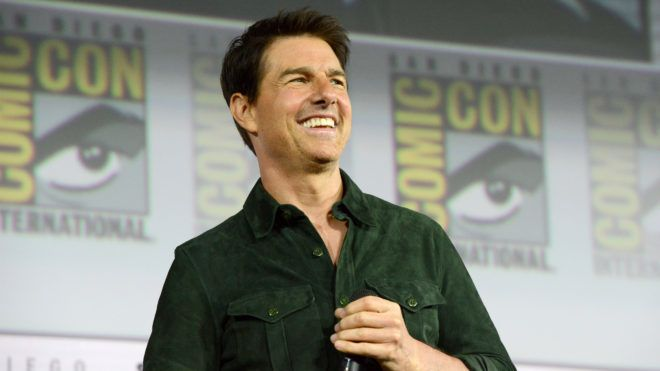 """SAN DIEGO, CALIFORNIA - JULY 18: Tom Cruise makes a surprise appearance to discuss """"Top Gun: Maverick"""" during 2019 Comic-Con International at San Diego Convention Center on July 18, 2019 in San Diego, California. (Photo by Albert L. Ortega/Getty Images)"""