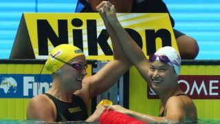 GWANGJU, SOUTH KOREA - JULY 22: (L-R) Silver medalist Sarah Sjostrom of Sweden and gold medalist Margaret MacNeil of Canada celebrate after the Women's 100m Butterfly Final on day two of the Gwangju 2019 FINA World Championships at Nambu International Aquatics Centre on July 22, 2019 in Gwangju, South Korea. (Photo by Catherine Ivill/Getty Images)