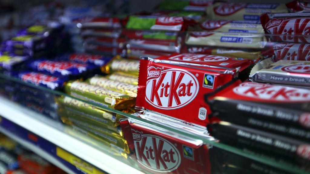 KitKat chocolate confectionary bars, manufactured by Nestle SA, sit displayed for sale in a newsagent's store in London, U.K., on Thursday, Oct. 17, 2013. The cost of chocolate is set to rise, propelled by raw sugar trading at a nine-month high and this year's 60 percent increase in cocoa butter combined with the arrival of Christmas demand. Photographer: Chris Ratcliffe/Bloomberg via Getty Images