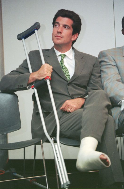 "LANDOVER, MARYLAND - JUNE 15:  (FILE PHOTO)  John F. Kennedy Jr. sits with his leg in a cast at the George Magazine ""Politicians vs Pundits"" auto race held at the U.S. Air Arena June 15, 1999 in Landover, MD. Kennedy who's magazine sponsored the event reportedly broke his ankle in a para-gliding accident. Four years ago on July 16, 1999, Kennedy and his wife, Carolyn Bessette Kennedy, and her sister, Lauren Bessette, died in a plane crash off the coast of Martha's Vineyard.  (Photo by Mario Tama/Getty Images)"