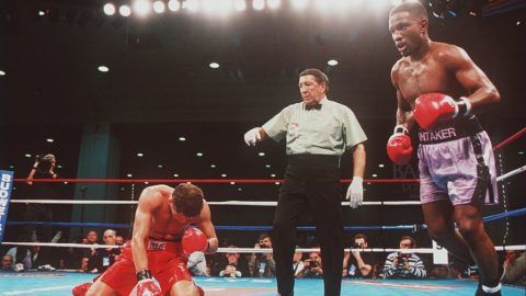 18 Nov 1995:  Pernell Whitaker (right) heads to neutral corner after knocking his opponent Jake Rodriguez to the canvas during the sixth round of their championship bout.  Whitaker won the fight with a sixth round knock out.   Mandatory Credit: Al Bello/A