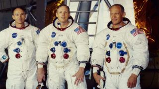 1969:  From left to right, astronauts Michael Collins, Neil Armstrong and Edwin 'Buzz' Aldrin Jnr, the crew of the lunar module Apollo 11 stand in front of a test module before their historic flight.  (Photo by MPI/Getty Images)