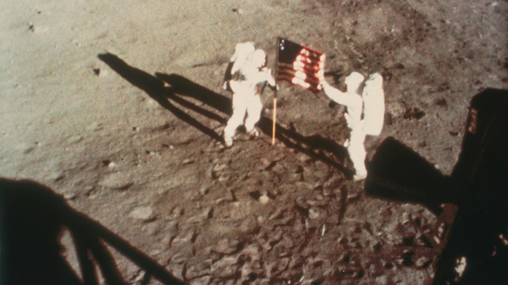 Armstrong and Aldrin unfurl the US flag on the moon, 1969. Apollo 11, the first manned lunar landing mission, was launched on 16 July 1969 and Neil Armstrong and Edwin Aldrin became the first and second men to walk on the moon on 20 July 1969. The third member of the crew, Michael Collins, remained in lunar orbit. (Photo by Oxford Science Archive/Print Collector/Getty Images)