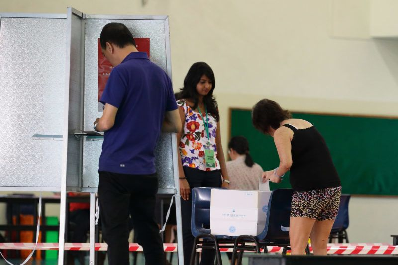 SINGAPORE - SEPTEMBER 11:  Residents cast votes at a polling station on  September 11, 2015 in Singapore.. About 2.5 million voters are expected to visit polling station islandwide. The 2015 general election sees all 89 parliamentary seats being contested for the first time since independence in 1965. This is also the first election in Singapore's history without founding Prime Minister, Lee Kuan Yew, who passed away in March this year.  (Photo by Suhaimi Abdullah/Getty Images)