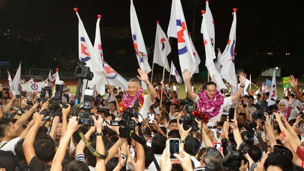 SINGAPORE - SEPTEMBER 11:  Prime Minister and People's Action Party (PAP) Secretary General, Lee Hsien Loong (L) and Dr Koh Poh Koon (R) celebrate after winning their seat for Ang Mo Kio Group Representation Constituency (GRC) on  September 11, 2015 in Singapore. The 2015 general election sees all 89 parliamentary seats being contested for the first time since independence in 1965. This is also the first election in Singapore's history without founding Prime Minister, Lee Kuan Yew, who passed away in March this year.  (Photo by Suhaimi Abdullah/Getty Images)
