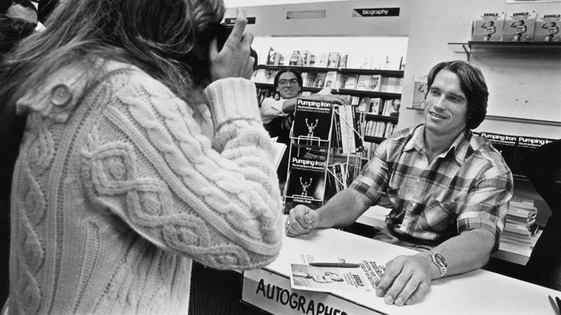 Arnold Schwarzenegger meets fans at a book signing for his autobiography/weight-training guide, 'Arnold: The Education of a Bodybuilder', Boston, Massachusetts, USA, 27th September 1978.  (Photo by Barbara Alper/Getty Images)