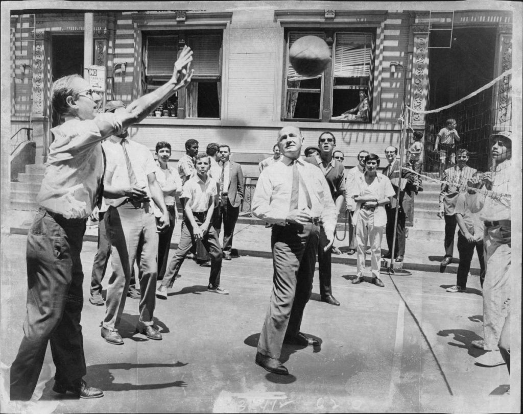 Just as U. S. Attorney Morgenthau did today, despite the 96 degree record heat for the year that turned the city into an oven, Police Commissioner Leary watches Morgenthau anxiously as he bats one back over net during a game of Volleyball on 13th Street between Second and Third Avenues. The two officials played with a group of neighborhood youngsters under a program sponsored by the Police Athletic League that will keep more than 80 city streets closed to traffic, but open for kids. July 01, 1968. (Photo by Vic DeLucia/New York Post Archives /(c) NYP Holdings, Inc. via Getty Images)
