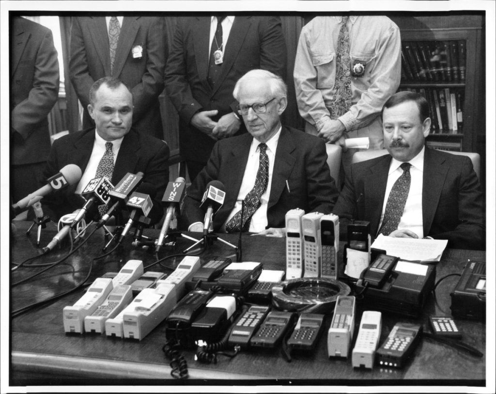 Police Commissioner Raymond Kelly, District Attorney Robert Morgenthau. & New York City Special Narcotics prosecutor Robert H. Silbering with ' clone' cellular phones in the foreground during press conference. November 22, 1993. (Photo by W. A. Funches Jr./New York Post Archives /(c) NYP Holdings, Inc. via Getty Images)