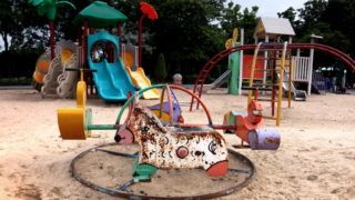 old dirty playground on sand