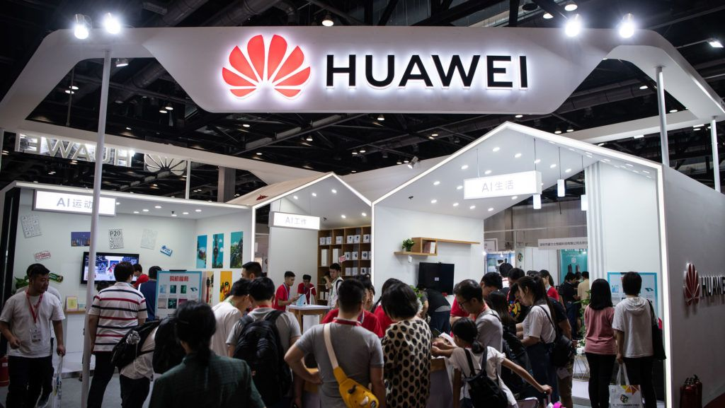 Attendees visit a Huawei exhibition stand during the Consumer Electronics Expo in Beijing on August 2, 2019. (Photo by FRED DUFOUR / AFP)