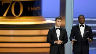 LOS ANGELES, CA - SEPTEMBER 17: Colin Jost (L) and Michael Che speak onstage during the 70th Emmy Awards at Microsoft Theater on September 17, 2018 in Los Angeles, California.   Kevin Winter/Getty Images/AFP