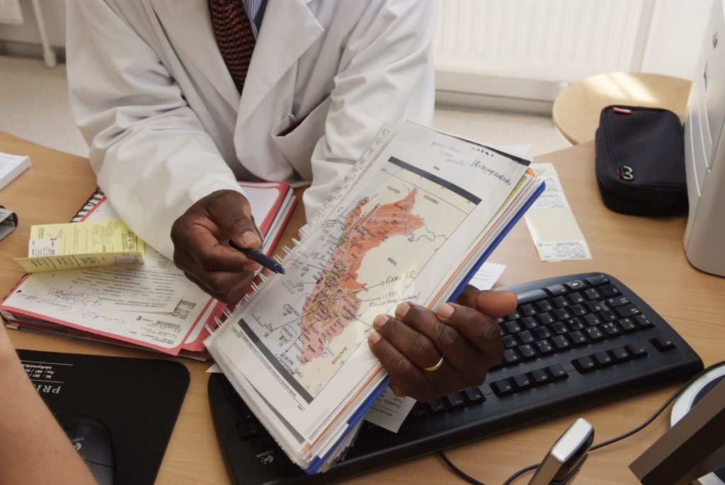 MALARIA PREVENTION  Photo essay from hospital, vaccination centre (Belgium). The doctor is showing the areas affected by malaria on a map of Peru.   CORTIER / BSIP