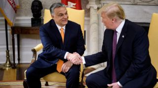 Hungary's Prime Minister Viktor Orban (L) and US President Donald Trump shake hands before a meeting in the Oval Office of the White House May 13, 2019, in Washington, DC. (Photo by Brendan Smialowski / AFP)