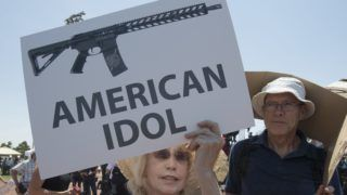 El Paso residents protest against the visit of US President Donald Trump to the city after the Walmart shooting that left a total of 22 people dead, in El Paso, Texas, on August 7, 2019. - President Donald Trump consoled victims of a mass shooting in Ohio on Wednesday but protesters and opponents denounced what they say is his extremist rhetoric on race and immigration. The president's trip to Dayton, where nine people were gunned down over the weekend, was to be followed immediately after by a stop in the border city of El Paso, Texas, where 22 were murdered. (Photo by Mark RALSTON / AFP)