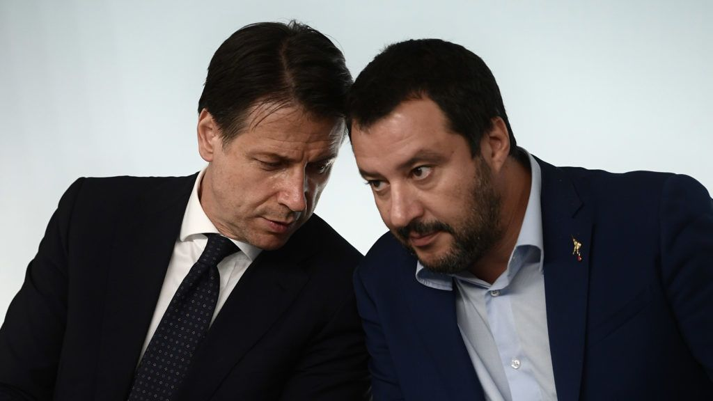(FILES) In this file photograph taken on October 15, 2018, Italy's Deputy Prime Minister and Interior Minister, Matteo Salvini (R) listens to Italy's Prime Minister Giuseppe Conte during a press conference following a cabinet meeting on the country's draft budget, prior to its submission deadline to the European Commission at Palazzo Chigi in Rome. - Matteo Salvini's summer 'Beach Tour', billed as a chance to woo voters with a view to possibly forcing early elections, got off to a bad start on August 7, 2019,  as Italy's populist government wobbled. (Photo by Filippo MONTEFORTE / AFP)