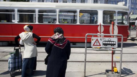 Austria, Vienna, two veiled women waiting to cross the ways and tram