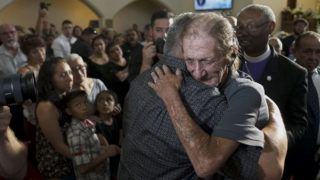 EL PASO, TX - AUGUST 16: Antonio Basco greets well wishers to a public memorial for his wife, Margie Reckard, on August 16, 2019 in El Paso, Texas. Reckard was one of 22 killed during the Walmart shooting in El Paso on August 3rd. Basco invited the public to attend the memorial in her honor and has laid fresh flowers everyday since the shooting at a make-shift memorial outside the outlet.   Sandy Huffaker/Getty Images/AFP