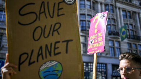 Extinction Rebellion demonstrator gather outside Brazilian embassy to protest and rise awareness about the massive fires in the Amazon rainforest, London on August 23, 2019. (Photo by Alberto Pezzali/NurPhoto)