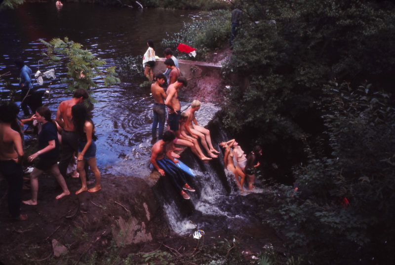 Young people playing in a stream and waterfall, during the Woodstock music festival, New York, US, August 1969. (Photo by Owen Franken/Corbis via Getty Images))
