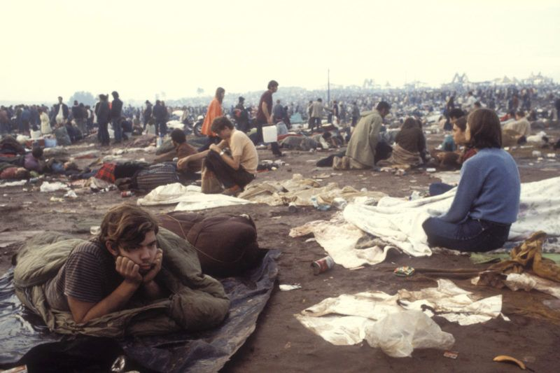 People in the messy field at the Woodstock Music Festival, New York, US, August 1969. (Photo by Owen Franken/Corbis via Getty Images))