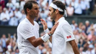 LONDON, ENGLAND - JULY 12: Roger Federer (R) of Switzerland greets Rafael Nadal of Spain after their Men's Singles semi-final match during Day eleven of The Championships - Wimbledon 2019 at All England Lawn Tennis and Croquet Club on July 12, 2019 in London, England. (Photo by Shi Tang/Getty Images)