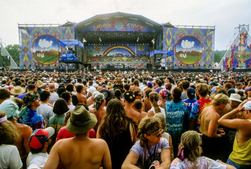 View of concert-goers in front of the main stage during the Woodstock '94 music festival at Winston Farms, Saugerties, New York, August 12, 1994. (Photo by Mark Reinstein/Corbis via Getty Images)
