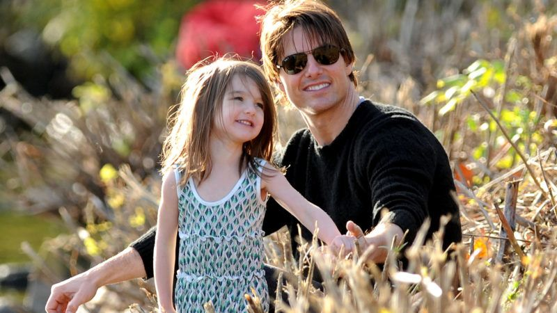 CAMBRIDGE, MA - OCTOBER 10:  Suri Cruise and Tom Cruise visit Charles River Basin on October 10, 2009 in Cambridge, Massachusetts.  (Photo by James Devaney/WireImage)