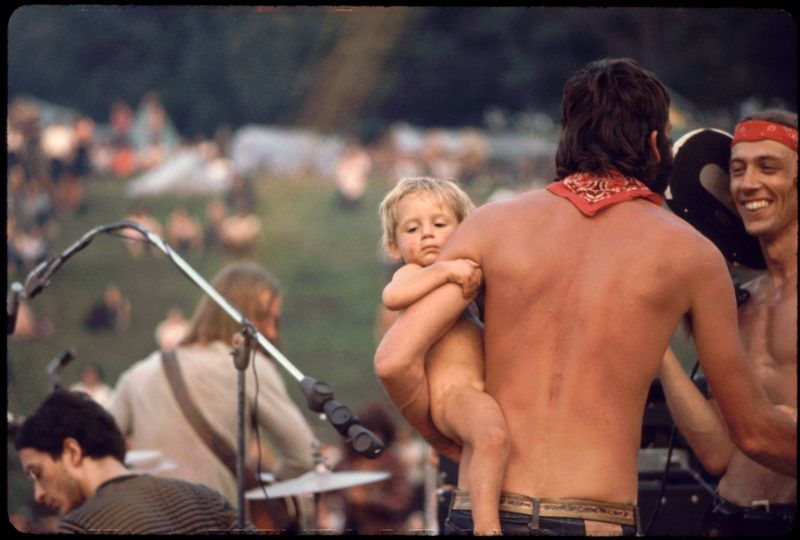 Ken Babbs, one of the Merry Pranksters, talks with a filmmaker at the Free Stage, at the Woodstock music festival, August 1969. (Photo by Ralph Ackerman/Getty Images)