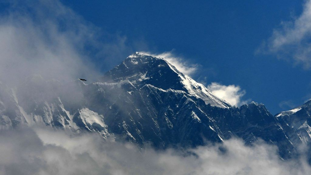 Mount Everest (height 8848 metres) is seen in the Everest region, some 140 km northeast of Kathmandu, on May 27, 2019. - Ten people have died in little more than two weeks after poor weather cut the climbing window, leaving mountaineers waiting in long queues to the summit, risking exhaustion and running out of oxygen. (Photo by PRAKASH MATHEMA / AFP)