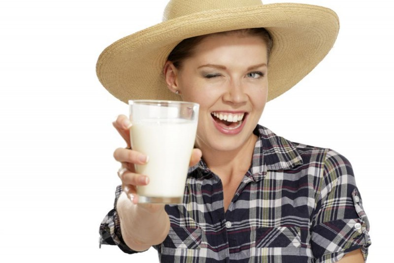 young woman  drinking milk on white