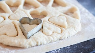 cookie cutters as heart and cut out cookie dough