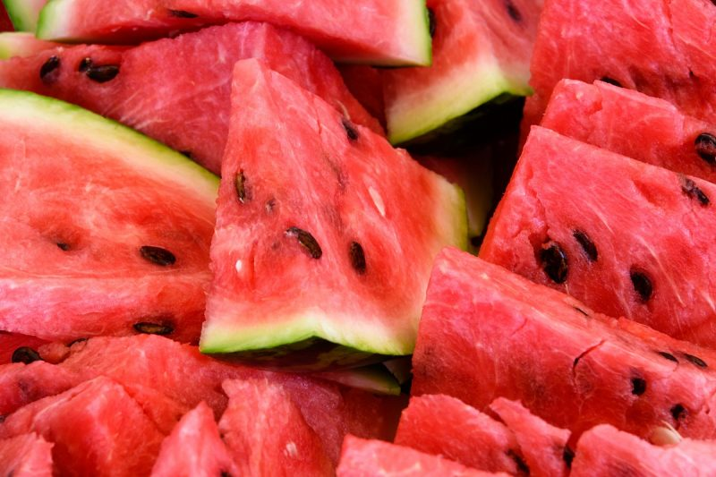 Food: slices of watermelon, arranged as background pattern, close-up shot
