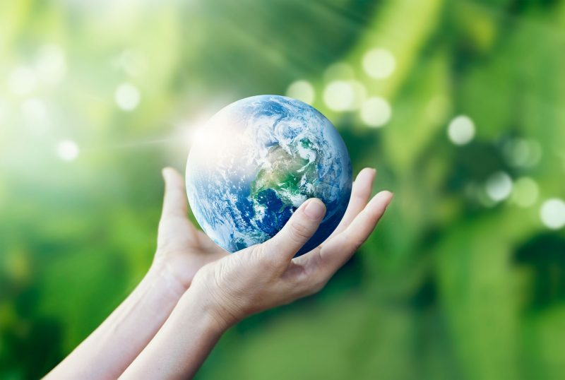 Hands holding and protect earth on nature background, Elements of this image furnished by NASA