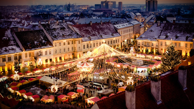 Christmas Market in Sibiu main square, Transylvania Romania. Beautifull sunset in the heart of Transylvania. City also known as Hermannstadt