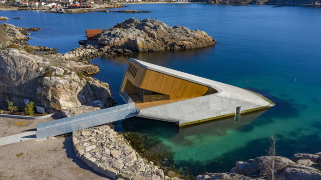 A restaurant named Under, that is semi-submerged beneath the waters of the North Atlantic in Lindesnes near Kristiansand, some 400 km south west of Oslo, is pictured on March 19, 2019. - The restaurant that is situated five and a half meters below the surface of the sea is scheduled to open on March 21, 2019. (Photo by Tor Erik SCHRODER / NTB Scanpix / AFP) / Norway OUT