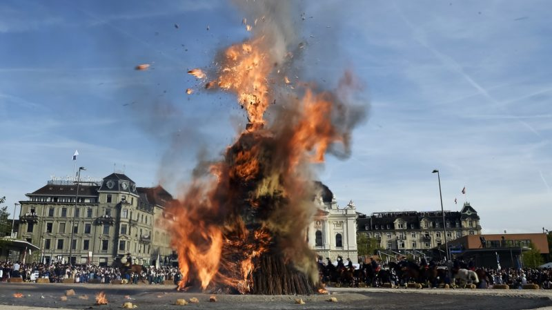 """The Boeoegg, a giant symbolic snowman made of wadding and and filled with firecrackers burns on top of a bonfire in Sechselaeuten square on April 24, 2017 in Zurich. - When the bells of the Saint Peter's church chime six o'clock, the bonfire under the snowman is set in fire and the guildsmen wearing historical costumes ride around the bonfire. The faster the head of the snowman explods the warmer and more beautiful the summer will be. (Photo by Michael Buholzer / AFP) / """"The erroneous mention[s] appearing in the metadata of this photo by Michael Buholzer has been modified in AFP systems in the following manner: [The Boeoegg, a giant symbolic snowman made of wadding and and filled with firecrackers burns on top of a bonfire in Sechselaeuten square on April 24, 2017 in Zurich. ] instead of [ANZAC soldier grave stones are pictured at the ANZAC cemetery near the ANZAC cove on April 24, 2017 in Canakkale before the ceremony celebrating the 102th anniversary of the Anzac Day.]. Please immediately remove the erroneous mention[s] from all your online services and delete it (them) from your servers. If you have been authorized by AFP to distribute it (them) to third parties, please ensure that the same actions are carried out by them. Failure to promptly comply with these instructions will entail liability on your part for any continued or post notification usage. Therefore we thank you very much for all your attention and prompt action. We are sorry for the inconvenience this notification may cause and remain at your disposal for any further information you may require."""""""