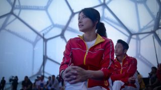 Chinese diver Guo Jingjing looks on during a ceremony to unveil the Chinese Olympic team's uniforms for the Rio 2016 Olympic Games, in Beijing on June 29, 2016. The uniforms were unveiled at a ceremony in the Water Cube, the venue for the swimming competition at the 2008 Beijing Olympic Games. / AFP PHOTO / WANG ZHAO