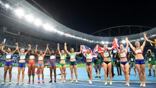 Silver medallist Britain's Jessica Ennis-Hill (4th R) and bronze medallist Canada's Brianne Theisen Eaton (3rd R ) celebrate with competitors after the Women's Heptathlon during the athletics event at the Rio 2016 Olympic Games at the Olympic Stadium in Rio de Janeiro on August 13, 2016.   / AFP PHOTO / FRANCK FIFE
