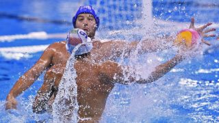 Serbia's Filip Filipovic vies with Italy's Christian Presciutti (back) during their Rio 2016 Olympic Games water polo semi final game on August 18, 2016 at the Olympic Aquatics Stadium in Rio de Janeiro.   / AFP PHOTO / GABRIEL BOUYS
