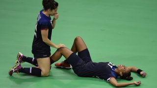 France's right wing Chloe Bulleux (L) and France's centre back Estelle Nze-Minko celebrate their victory and qualification for the final at the end of the women's semifinal handball match Netherlands vs France for the Rio 2016 Olympics Games at the Future Arena in Rio on August 18, 2016. / AFP PHOTO / JAVIER SORIANO