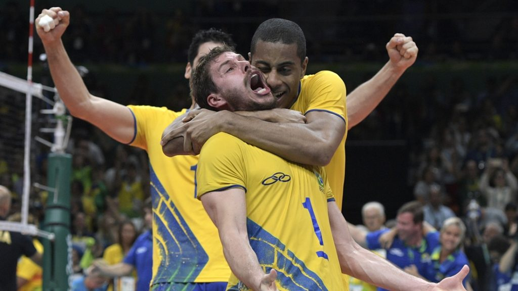 Brazil's Bruno Mossa De Rezende reacts after winning the men's Gold Medal volleyball match against Italy at the Maracanazinho stadium in Rio de Janeiro on August 21, 2016, at the Rio 2016 Olympic Games. / AFP PHOTO / Juan Mabromata
