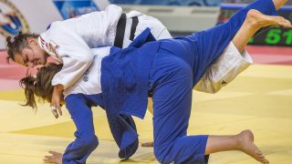 Hungary's Abigel Joo (white) fights against Croatia's Ivana Maranic during their women's qualification bout, in the -78kg category at the the IJF Judo World Championship in Astana, on August 28, 2015. AFP PHOTO / JACK GUEZ / AFP PHOTO / JACK GUEZ
