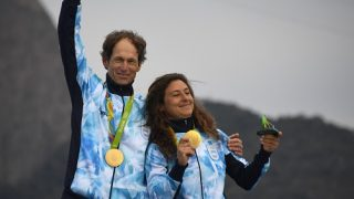 Argentina's gold medallist Santiago Lange and Cecilia Carranza Saroli pose on the podium after the Nacra 17 Mixed medal race at Marina da Gloria during the Rio 2016 Olympic Games in Rio de Janeiro on August 16, 2016 / AFP PHOTO / Damien MEYER