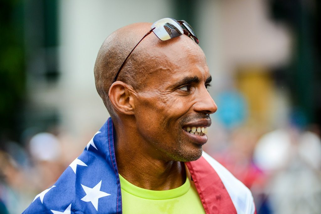 SAN DIEGO, CALIFORNIA - JUNE 05: 4-time Olympian Meb Keflezighi poses with the Stars and Stripes flag after finishing the half marathon during the 19th running of the Suja Rock 'n' Roll San Diego Marathon on June 5, 2016 in San Diego, California.   Kent Horner/Getty Images for Rock 'n' Roll Marathon Series/AFP / AFP PHOTO / GETTY IMAGES NORTH AMERICA / Kent Horner