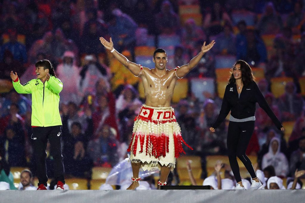 RIO DE JANEIRO, BRAZIL - AUGUST 21:  Pita Taufatofua of Tonga jumps on stage during the Closing Ceremony on Day 16 of the Rio 2016 Olympic Games at Maracana Stadium on August 21, 2016 in Rio de Janeiro, Brazil.  (Photo by Ezra Shaw/Getty Images)