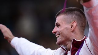 Hungary's silver medalist Miklos Ungvari celebrates on the podium of the men's -66kg contest of the judo event at the London 2012 Olympic Games on July 29, 2012 ExCel arena in London. AFP PHOTO / FRANCK FIFE / AFP PHOTO / FRANCK FIFE