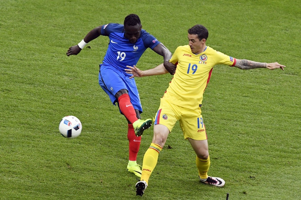 France's defender Bacary Sagna (L) vies with Romania's forward Bogdan Stancu during the Euro 2016 group A football match between France and Romania at Stade de France, in Saint-Denis, north of Paris, on June 10, 2016. / AFP PHOTO / MIGUEL MEDINA